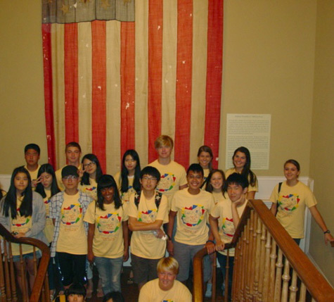 Students pose for a group photo on the stairs at the museum.