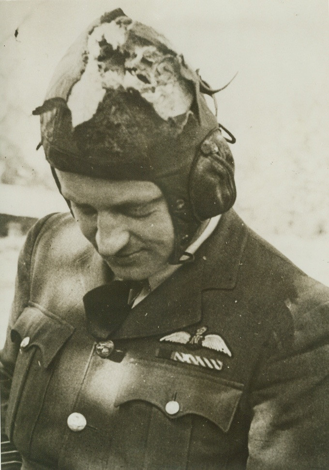 BETWEEN HIM AND DEATH, 5/23/1943. This shredded leather helmet is all that stood between Wing Commander Arthur Hay Donaldson and death when he led a flight of whirlwind fighters in a recent low-level attack on Morlaix airfield. Explosive shells from a ground battery reached his plane, and one went through his cockpit hood and tore through his helmet. Uninjured, the RAF man was knocked unconscious, but he soon recovered to keep his Whirlwind from crashing and fly back across 100 miles of channel to his base. Credit: ACME;