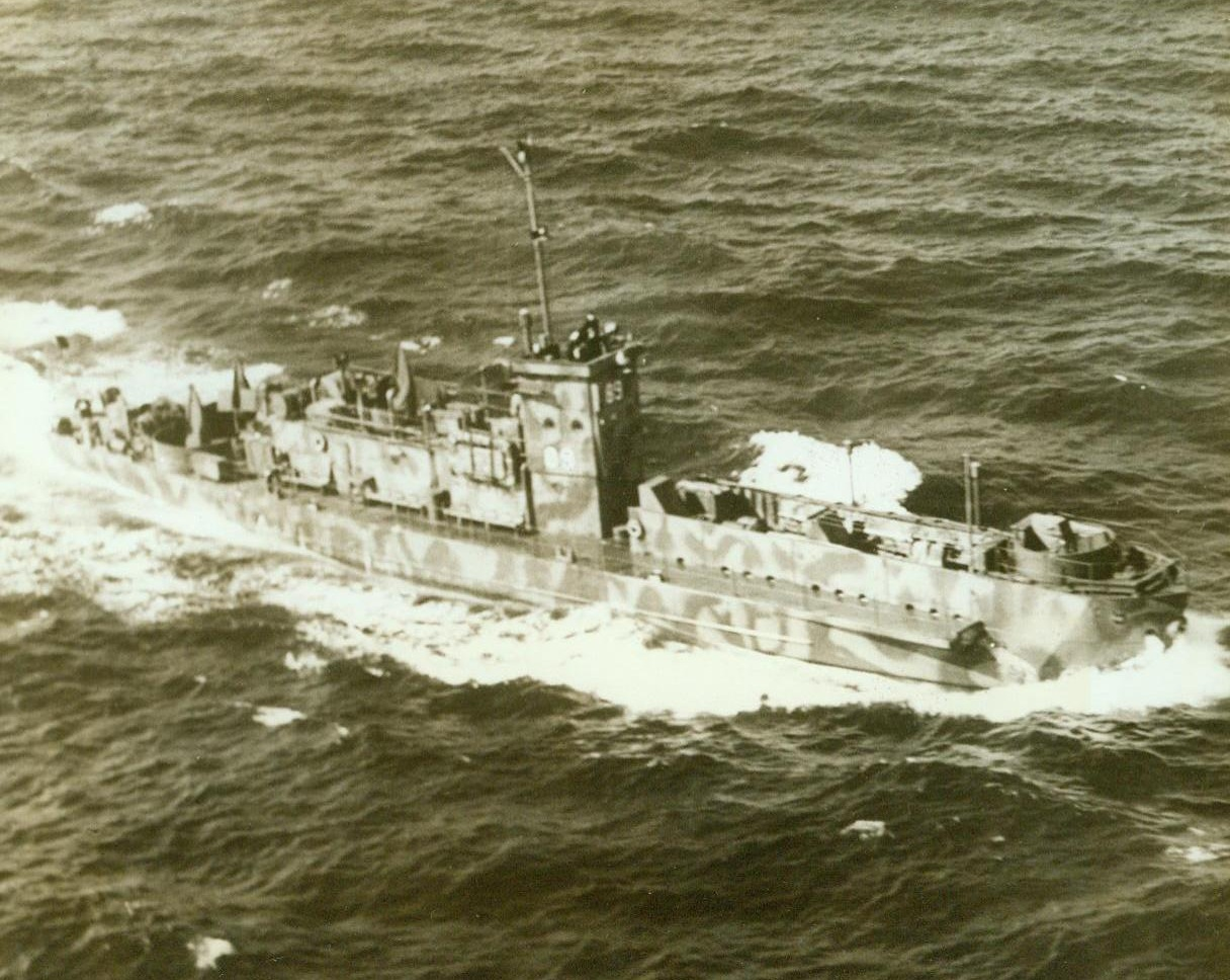 NEW TYPE INVASION BARGE, 5/22/1943. Ready to carry troops where they're needed, this new-type invasion barge, the Navy's L.C.I., cuts through the water off the Atlantic coast. The camouflaged vessel operates under the Navy Amphibious Force. Credit (Official U.S. Coast Guard Photo – ACME);