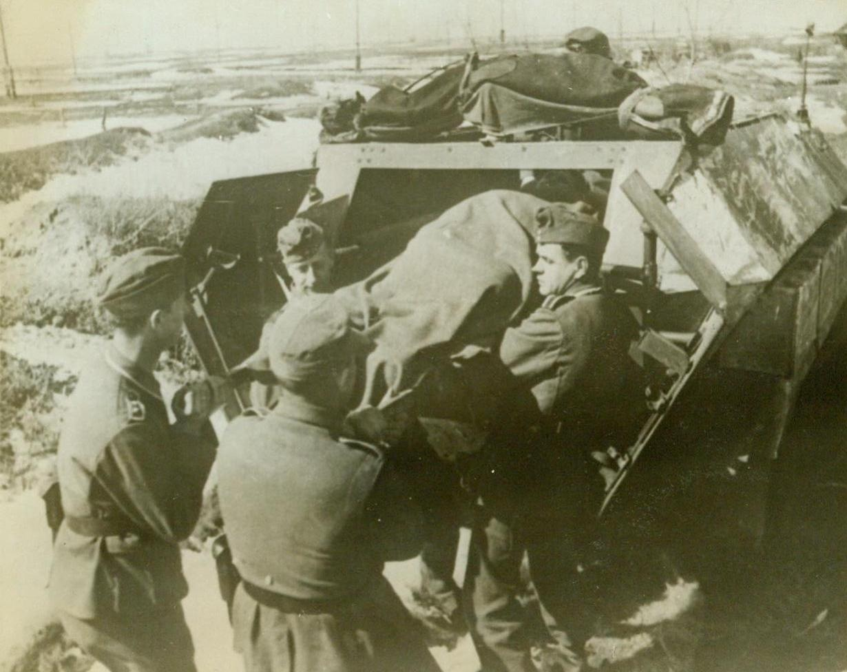 PLENTY OF BUSINESS FOR NAZI AMBULANCES, 5/21/1943. A wounded Nazi soldier is removed from an ambulance just back from a battlefield. Although the original German caption gave no location for this war scene, the snowy terrain indicates that it is somewhere on the Russian front. Photo arrived by clipper from London Credit Line (ACME);