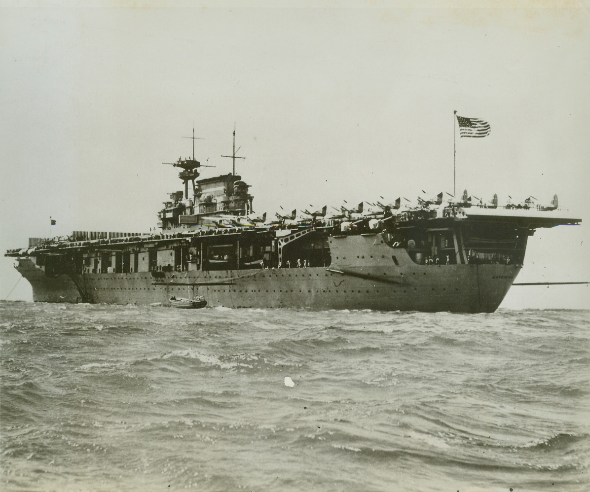 """""""Workhorse of War"""", 5/31/1943. The unprecedented combat record of the aircraft carrier U.S.S. Enterprise recently earned her a unit citation conferred by President Roosevelt. The Navy revealed tonight that the five-year-old ship has inflicted damage on the enemy estimated at eight to ten times her own cost. Planes, submarines, all types of enemy surface vessels, and shore installations have been destroyed or badly damaged in record number by the aircraft carried on the 19,900-ton carrier. Credit (Official U.S. Navy Photo-ACME);"""