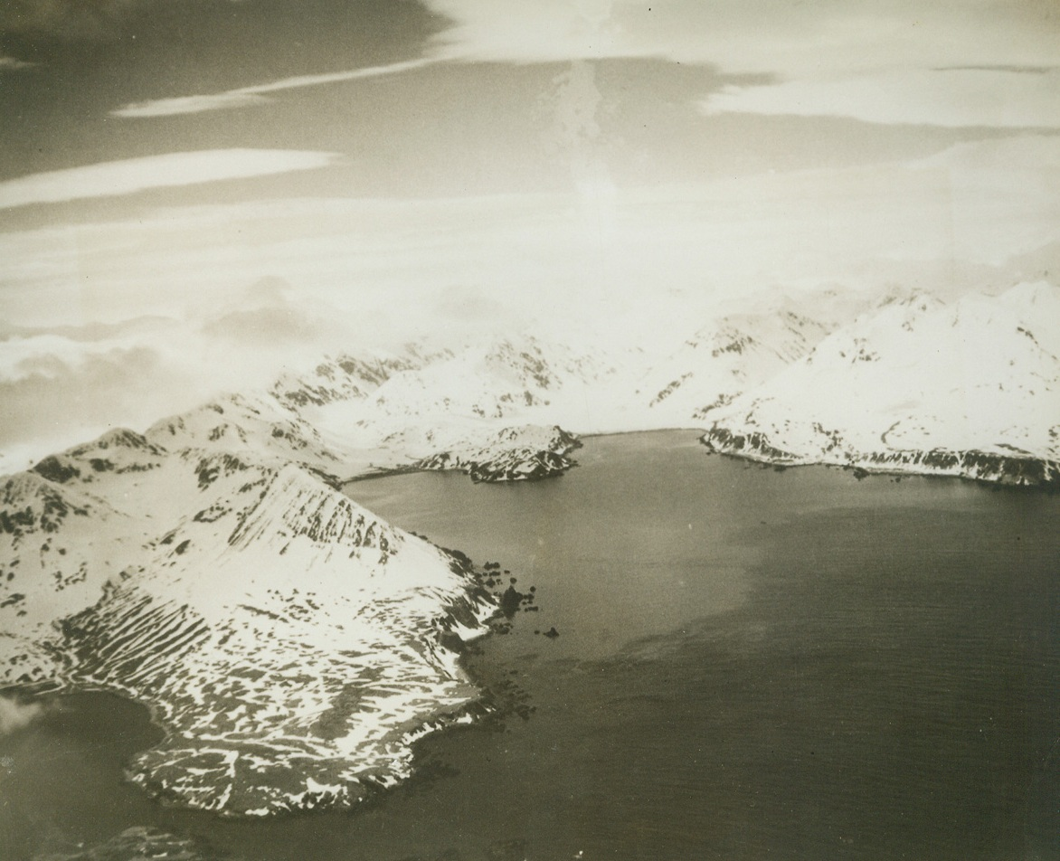 WHERE AMERICANS ADVANCED ON ATTU, 5/19/1943. Advance patrols of American forces which landed in the Holtz Bay and Massacre Bay area have joined. The tow arms of Holtz Bay are shown in the center of the photo, American forces attacked Jap positions on the high ground between the arms and took possession of the area. As the forces from Massacre Bay (not shown) advanced northward, the Holtz Bay units took possession of the high ridge to the southeast (from center of the picture to the left). The advance units from Massacre Bay and Holtz Bay met in a pass, which has been cleared of enemy troops. The troops withdrew toward Chichagof Harbor (extreme lower left). The village of Attu, only settlement on the island, faces Chichagof Harbor. Credit: U.S. NAVY PHOTO FROM ACME.;