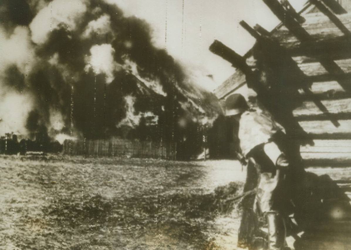 Axis Raid on Jugoslav Partisans, 5/19/1943. Jugoslavia – A German anti-partisan patrol explodes a munition depot after tracking down a partisan supply headquarters somewhere in Jugoslavia. Activities of these patriots have forced Hitler to keep a large contingent of troops in the occupied country. Photo received from a neutral source, was radioed from Stockholm to New York today (May 19). Credit: ACME Radiophoto;