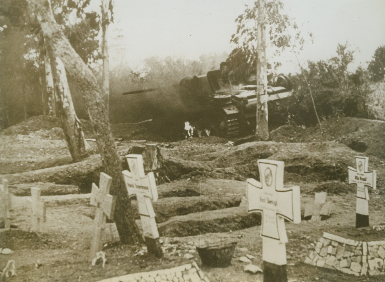 Nazi Tank In Nazi Graveyard, 5/19/1943. Tunisia: - A German tank which met a fate similar to some of the Nazi fighting men.  Artillery fire of the British knocked it out of action in the shadow of crosses over graves of Afrika Corpsmen killed in the battle of North Africa.  Action took place on the outside of Tunis. Credit Line (ACME);