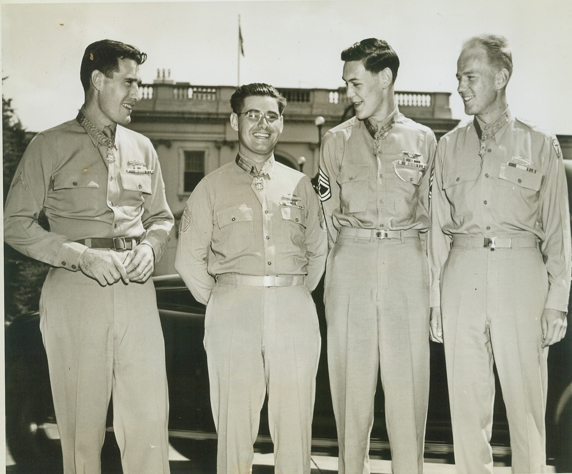 RECEIVE NATION'S HIGHEST AWARD FROM FDR, 8/30/1944. Washington, DC – On the White House lawn is this quartet of war heroes after each had been presented with the Medal of Honor, the Nation's highest award for gallantry, by President Roosevelt.  They are (left to right) Pfc. William J. Johnston, Colchester, Conn., machine gunner who held off two German counterattacks and stuck to his gun although his comrades thought him mortally wounded; S/Sgt. Jessie R. Drowley, Luzerne, Mich., who was cited for heroism on Bougainville; T/Sgt. Forrest L. Vosler, Livonia, N.Y., who received an eye injury and other wounds on a Bremen raid and asked to be tossed from the plane to lighten its load; and 1st Lt. Arnold L Bjorklund, Seattle, Wash., who used three hand grenades to destroy two machine guns, a heavy mortar, and to kill seven Germans. NY#12 DJH LON 70 CEP LV SEA CAN.  Credit Line (ACME);