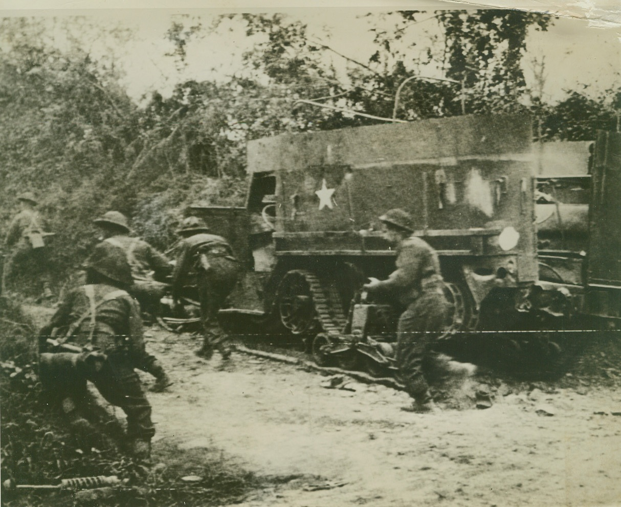MOPPING UP, 8/7/1944. FRANCE – Crouching as they run, troops of the British Second Army dash ahead on a road near Tracy Bocage. The fighting men are mopping up during their army's advance across France. Credit: British official photo via U.S. Signal Corps radiotelephoto from ACME;