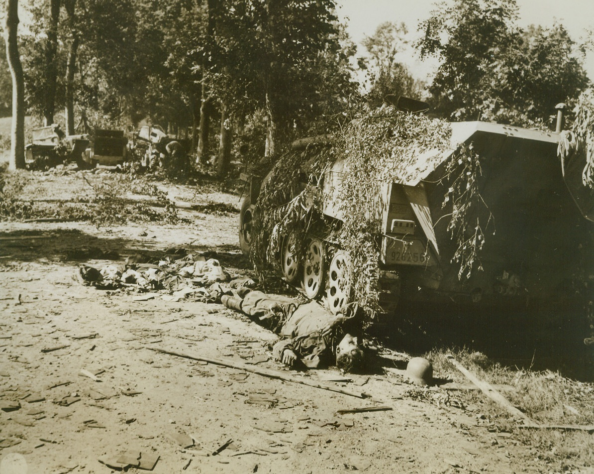 Attempted Retreat Ends in Death, 8/22/1944. FRANCE – This German soldier was killed s he attempted to flee from his half-track vehicle as German forces retreated toward Mortain, France.  Other vehicles in his unit (background) were also knocked out as they fled homeward. Credit; (Signal Corps Photo From ACME);