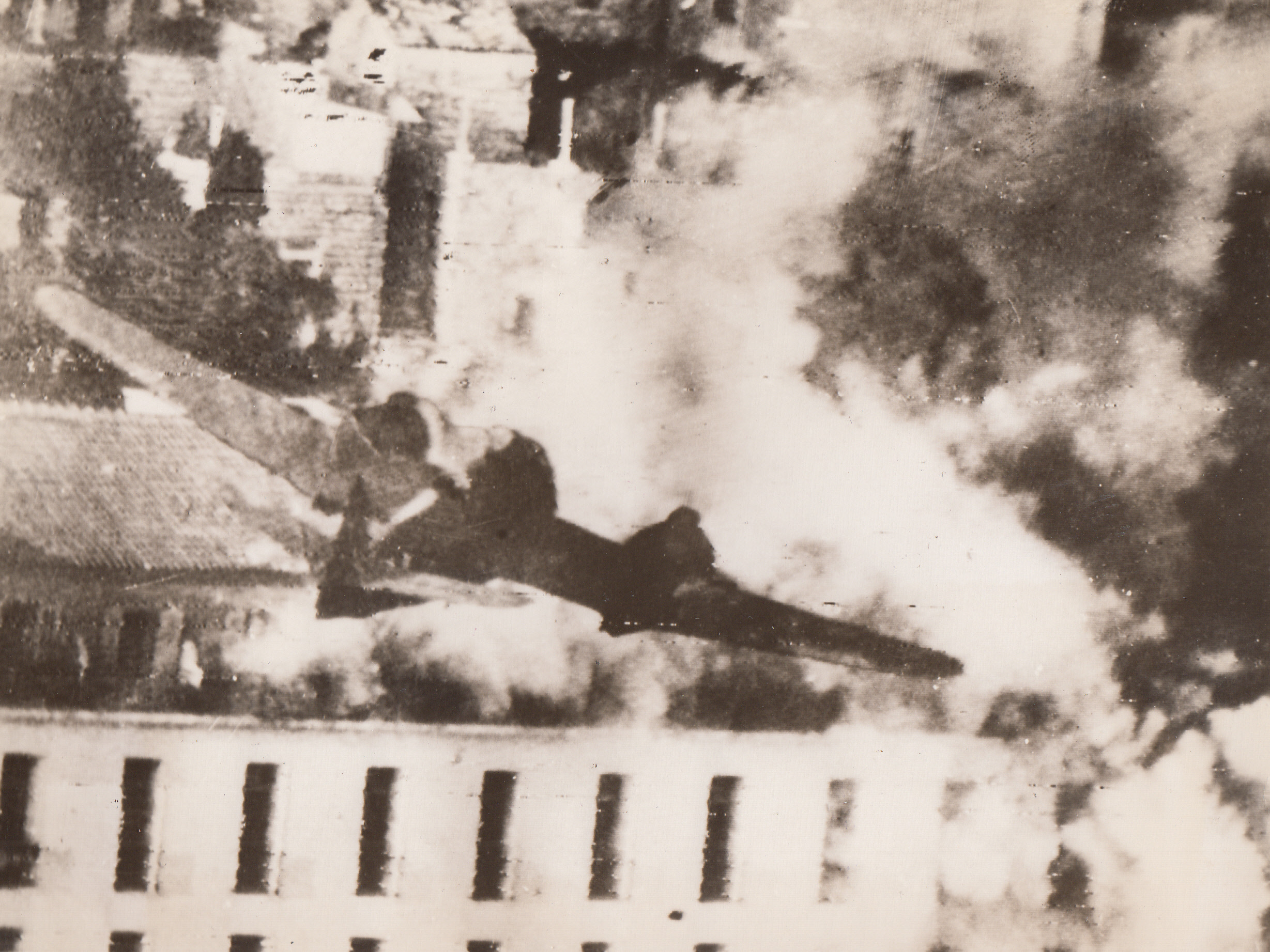 COMING IN A ROOF-TOP LEVEL, 8/22/1944. YUGOSLAVIA—A rocket-carrying Beaufighter of the Balkan Air Force goes in at roof-top level to loose its cargo of destruction on the already smoking building, suspected of being German headquarters, in Dubrovnik, Yugoslavia.;
