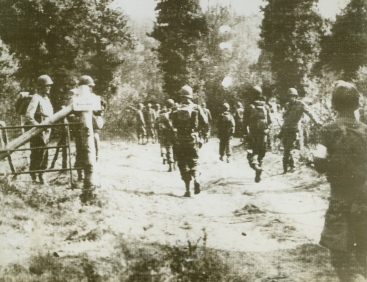 Yanks Skirt Aachen, 8/17/1944. GERMANY – Moving across the border from Belgium, Yanks advance up a road leading to Aachen Staat forest in Germany. American forces have entered the town proper and the Germans are engaging in a desperate house-to-house fight against overwhelming odds. Credit (Signal Corps Radiotelephoto from ACME);