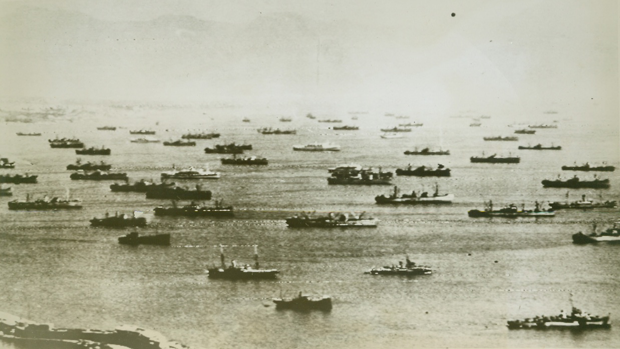 Headed for Southern France, 8/15/1944. Flashed to the U.S. today by Radiotelephoto as the invasion of Southern France was announced this photo shows approximately 75 ships assembled at a port in Southern Italy, ready to leave for the new invasion. Credit Line (Army Radiotelephoto from ACME);
