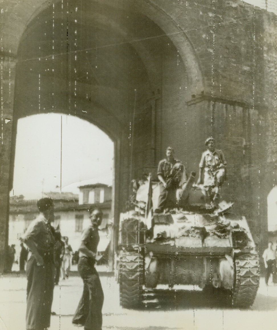 British Tank Enters Florence, 8/8/1944. FLORENCE, ITALY – Crewmen stand atop their British tank as it enters Florence through the Porta Romano. It is manned by soldiers of the South African unit of the British 8th Army, which were first to enter Florence.Credit (British Official Radiotelephoto via OWI from ACME);