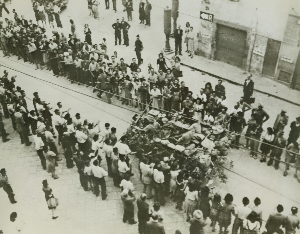 Florentines Cheer Allied Heroes, 8/7/1944. FLORENCE, ITALY – Joyous, cheering throngs line the route as Allied troops make their victorious entry into the southern outskirts of Florence. A vehicle of the South African armored force passes down the aisle formed by applauding, waving natives.Credit (Signal Corps Radiotelephoto from Acme);