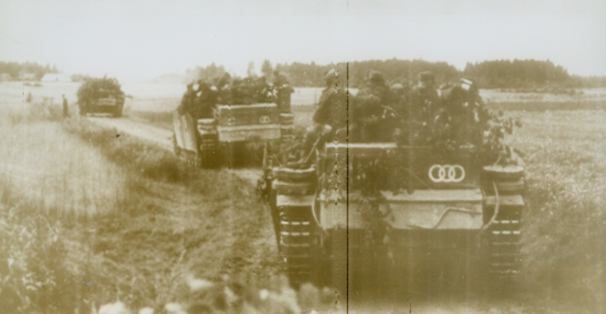 """Tank Evacuation for German Soldiers, 8/22/1944. According to the German caption accompanying this photo, radioed from Stockholm today (August 22), the picture shows """"a defense battle on the east front."""" It actually shows tanks being used to transport German soldiers in their retreat from the front.Credit (Acme Radiophoto);"""