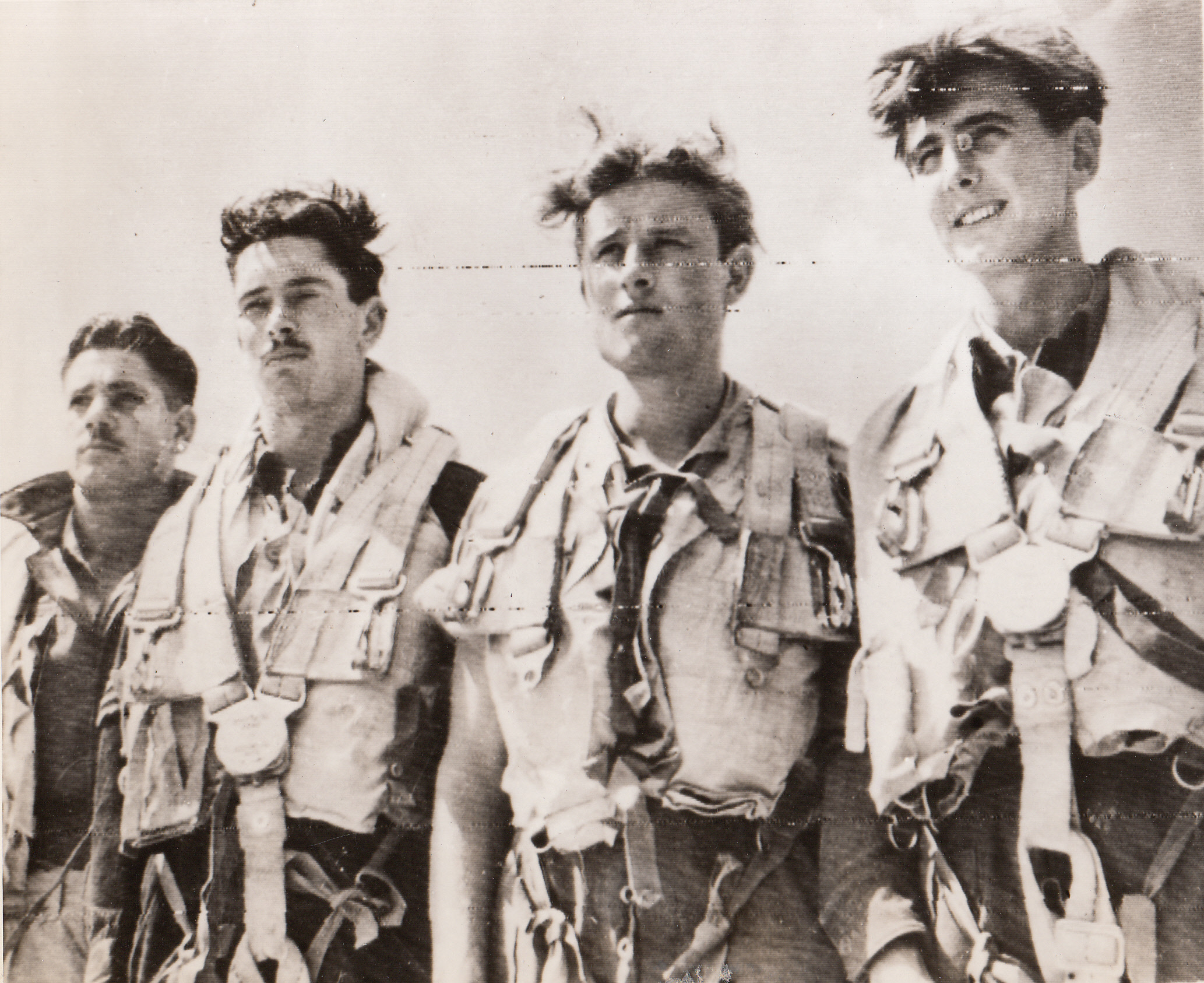 Flew Supplies to Warsaw Patriots, 8/23/1944. ITALY – Back at their base in Italy are these four members of an RAF Liberator crew who recently flew from Italy to Warsaw and back to drop supplies to patriots battling the Nazis in the Polish capitol. They are (left to right): F/S Kenneth Pearce, Sgt. Peter Green, Sgt. Derek Coates, and Sgt. John Rush.;