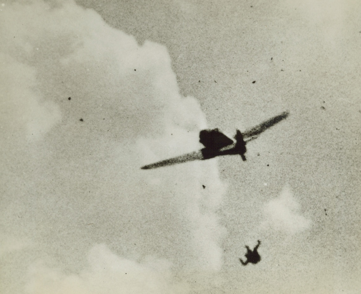 Nazi Hits the Silk, 8/23/1944. Arms and legs all akimbo, a Luftwaffe fighter pilot tumbles earthward, his plane flying on, still level, without him. A U.S. Army 8th Air Force fighter pilot attacked the enemy craft somewhere over France and although the plane seems unharmed, the pilot, unnerved by hits Yank scored, baled out.Credit (USAAF Photo from Acme);