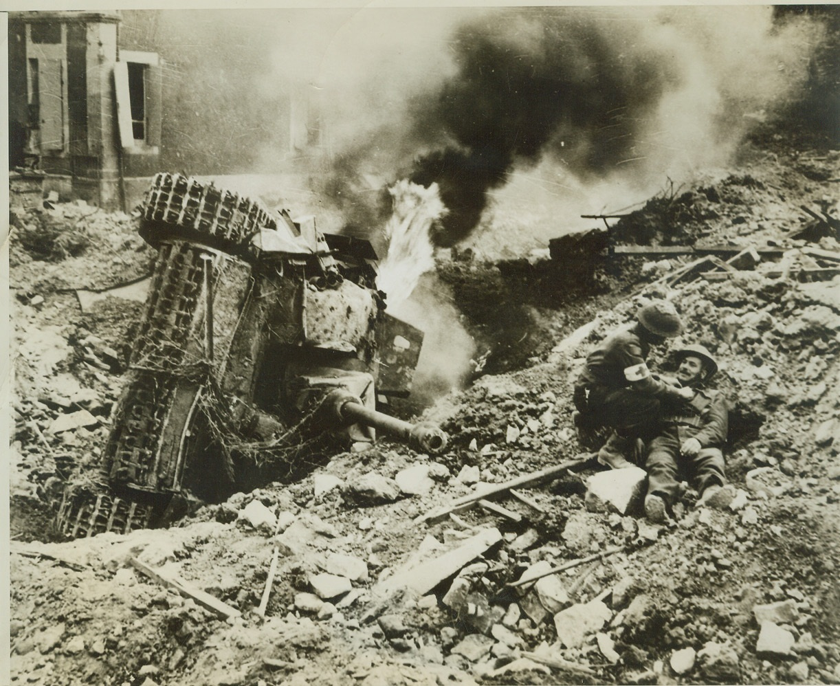 Trap Closes on Nazis, 8/16/1944. FRANCE -- A German tank, overturned in a deep bomb crater, burns fiercely along the road to Falaise, where Allied forces are closing a trap on the German 7th Army, which has already been torn to ribbons. At right (photo above) a medical orderly looks over a Canadian soldier who has fallen but is uninjured. Credit: (ACME) (WP);