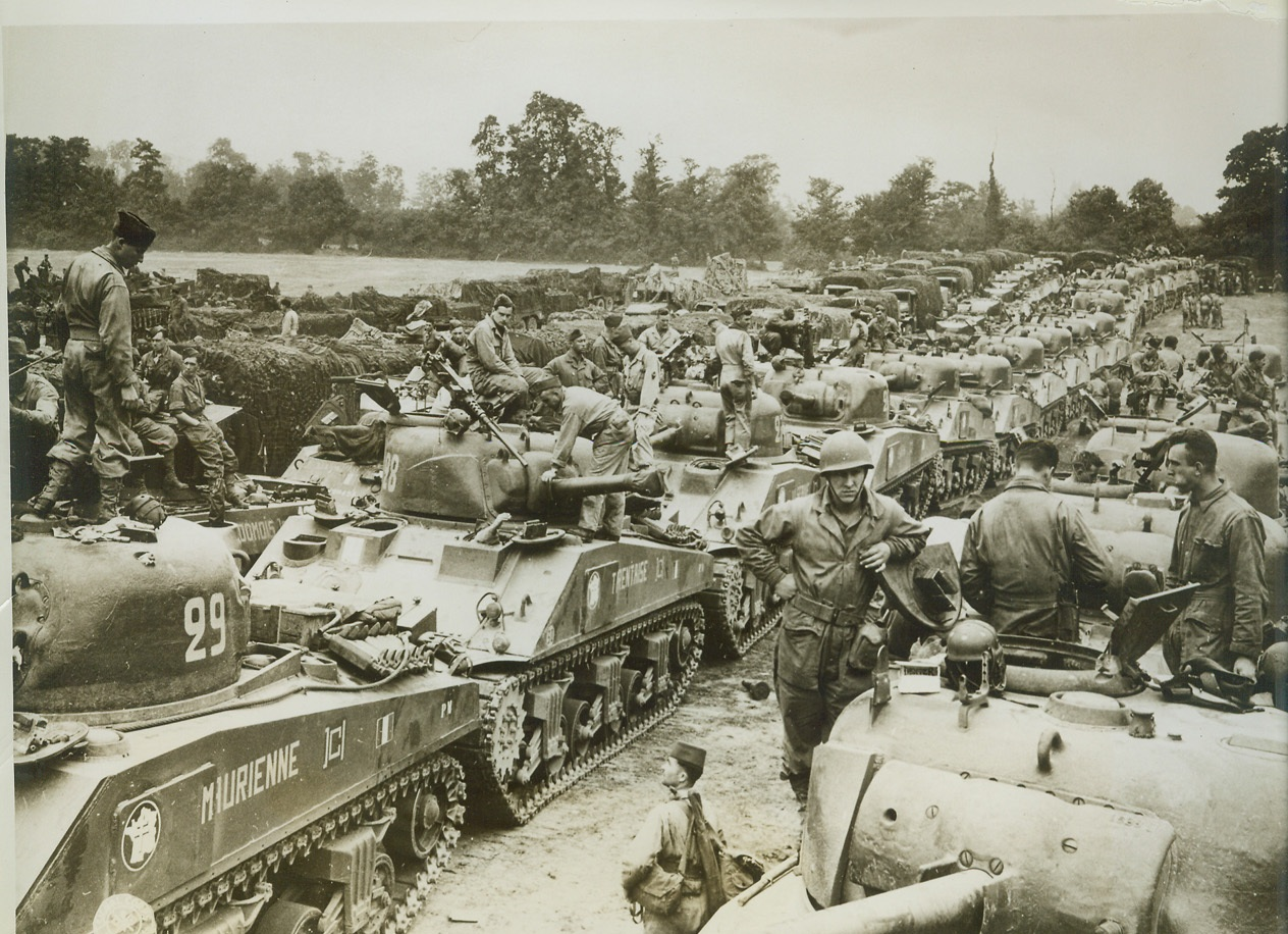 Free French on Way to Free France, 8/15/1944. Free French troops with their armored vehicles shown at a transient area somewhere in the European Theater of Operations just before hopping to the Continent in support of the Allied attack to free France from the Nazis. Credit: (Signal Corps Photo from ACME);