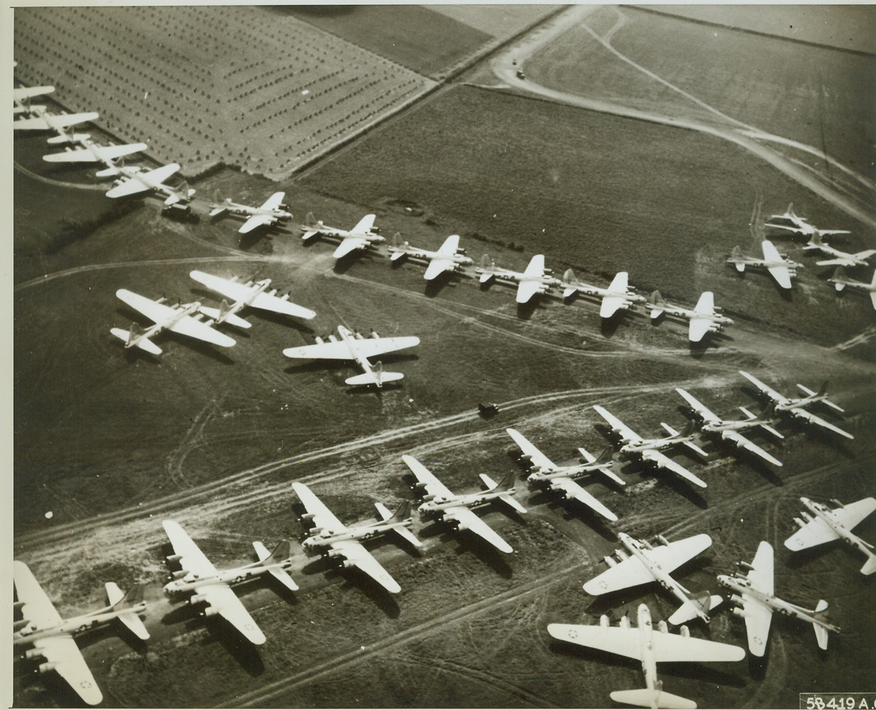 Aerial Might on Display, 8/23/1944. ENGLAND -- A tribute to American labor and production power one of the largest group of B-17 Fortresses ever seen together in the confines of a photograph are lined up and ready for combat. This is only a small portion of the aerial might which is assembled in England as replacements for the strategic bombers of the U.S. Army 8th Air Force. Credit (USAAF Photo from ACME);