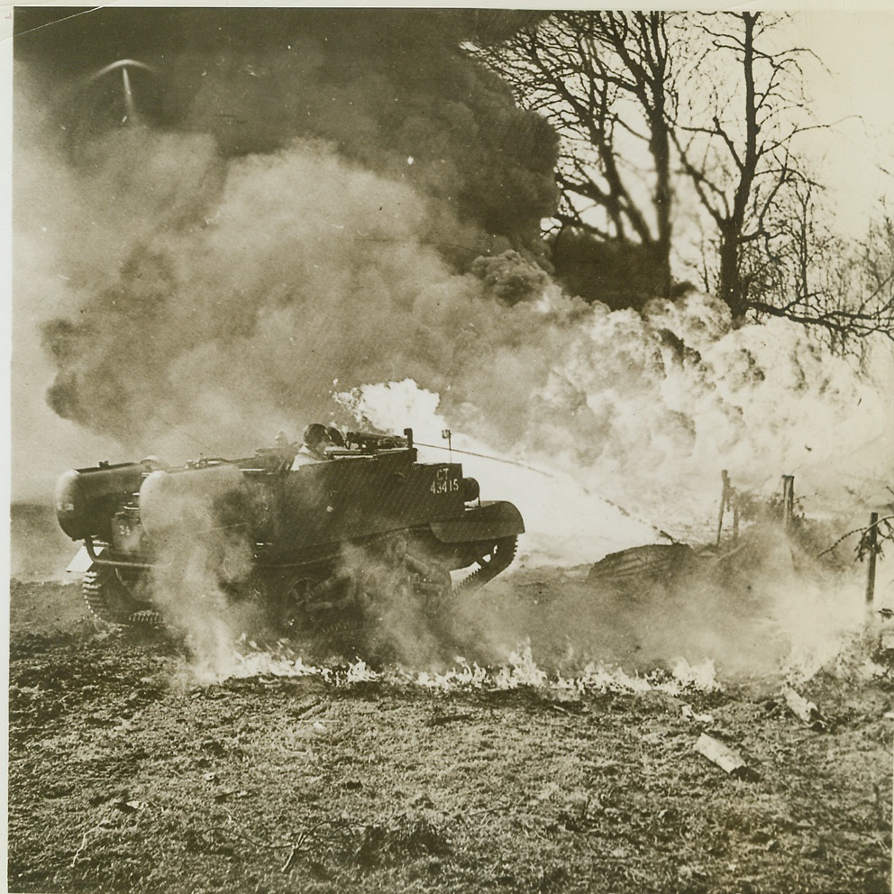 """""""Wasp"""" Packs a Flaming Sting, 8/30/1944. Among the powerful flame-throwers now being used by British Armies in France is the ferocious """"Wasp"""". Sending a fearsome stream of fire into German strongpoints, the flame-thrower is fitting to a carrier with a bullet-proof body. In the """"Wasp"""", as in all other weapons of this kind, a special type of fuel is used. Credit (British Official Photo from ACME);"""
