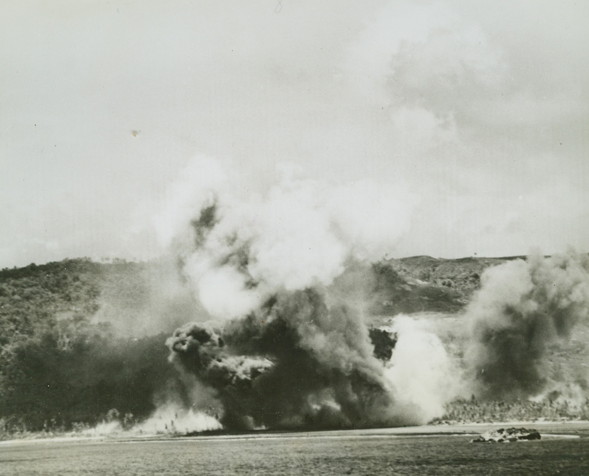 Pre-Invasion Bombardment on Guam, 8/2/1944. Guam Is. – Grey and black smoke rises in huge billows from the shores of Guam, as US Navy guns and planes hammer at the Jap installation on July 21 to soften it for Marine and Army landing forces.Credit: Official US Navy photo from ACME;