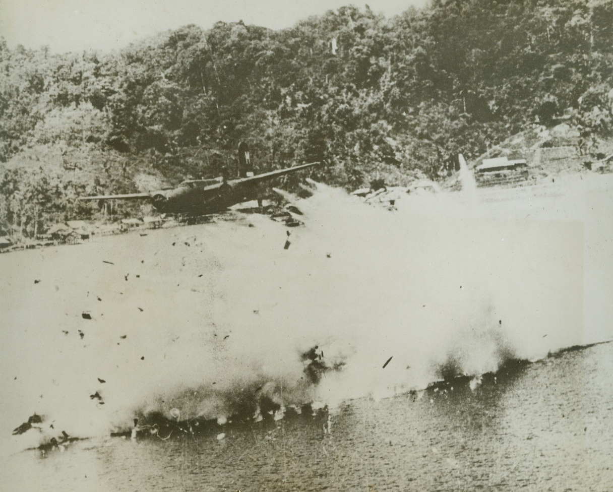 The Last Flight of a Yank Bomber - #2, 8/10/1944. KOKAS, DUTCH NEW GUINEA – What was once an A-20 attack bomber is now but a mass of smoke and flying parts as the plane explodes after crashing into the sea, a victim of a direct ack-ack hit. A companion ship heads safely homeward from a low-level raid on Jap installations at Kokas, Dutch New Guinea. Credit: USAAF photo from ACME;