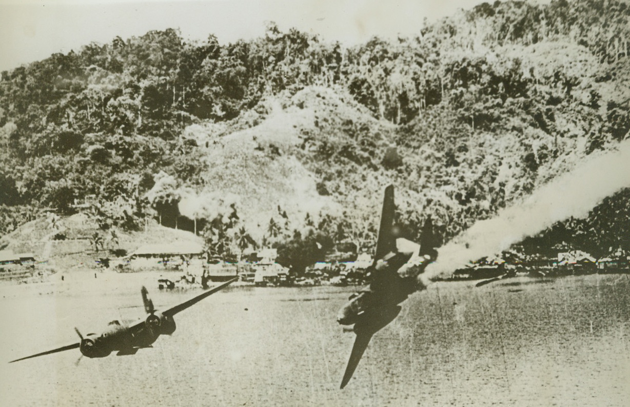 The Last Flight of a Yank Bomber - #1, 8/10/1944. KOKAS, DUTCH NEW GUINEA – In a slow, graceful dive, an A-20 attack bomber heads for the sea on its final flight after being hit by ack-ack bursts. A companion ship at left maneuvers for safety. Smoke streaming from the tail of the wounded craft marks a trail of death, as the ship was too low to permit crewmen to parachute. Both planes were returning from a low-level raid on Jap installations at Kokas, Dutch New Guinea. Credit: USAAF photo from ACME;