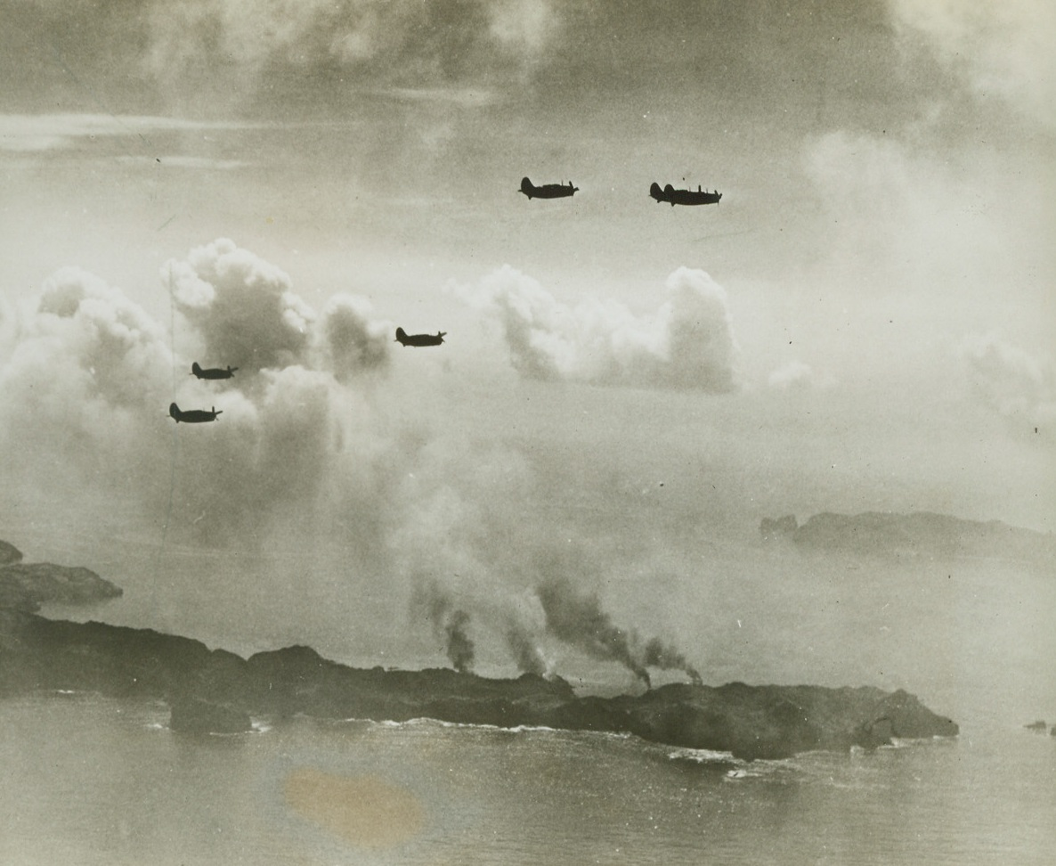 Only 600 Miles from Tokyo, 8/9/1944. BONIN ISLANDS – With smoke rising from the ruins of four ships at Haha Jima below them, five helldivers of a Pacific Fleet task force slip back into formation to return to their carriers. In attacks on Haha Jima and Chichi Jima, both in the Bonin group, 600 miles south of Tokyo, our planes sank at least 13 Jap ships and damaged more than 20. Thirty-two enemy planes were shot down and 96 were damaged. Credit: Official U.S. Navy photo from ACME;