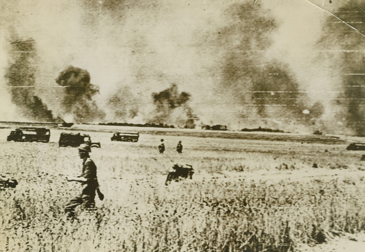 AIR SUPPORT FOR ADVANCING ALLIES, 8/12/1944. CAEN, FRANCE – Bombs burst on German positions South of Caen as fortresses attack after the great RAF raids which softened up the enemy for attack by British and Canadian forces advancing on land. Credit: British official photo via Signal Corps radio telephoto from Acme;