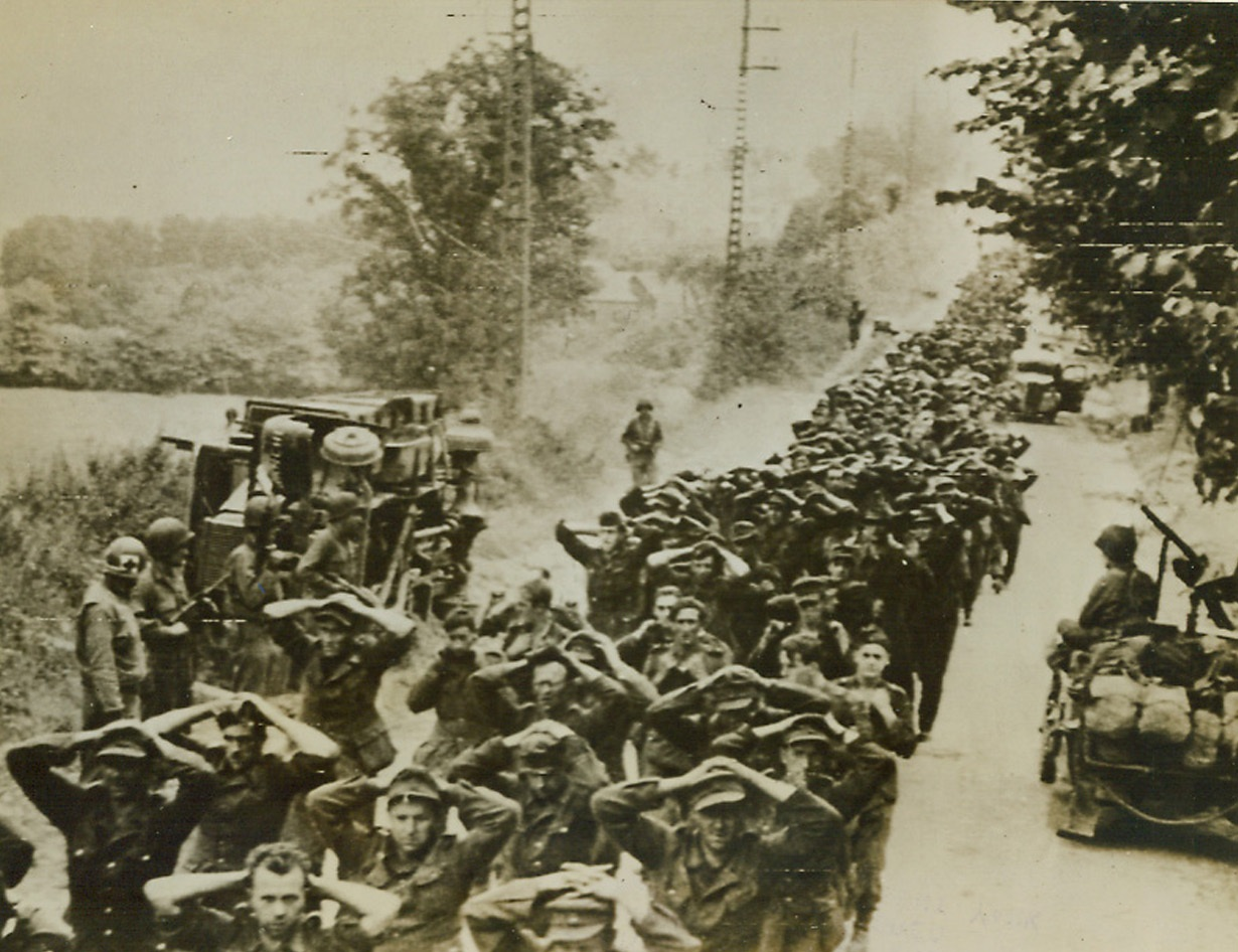 RESULTS OF YANK BREAKTHROUGH IN BRITTANY, 8/5/1944. FRANCE—Hundreds of German prisoners are marched to the rear after being captured during the initial stages of the current Yank offensive in Brittany.;