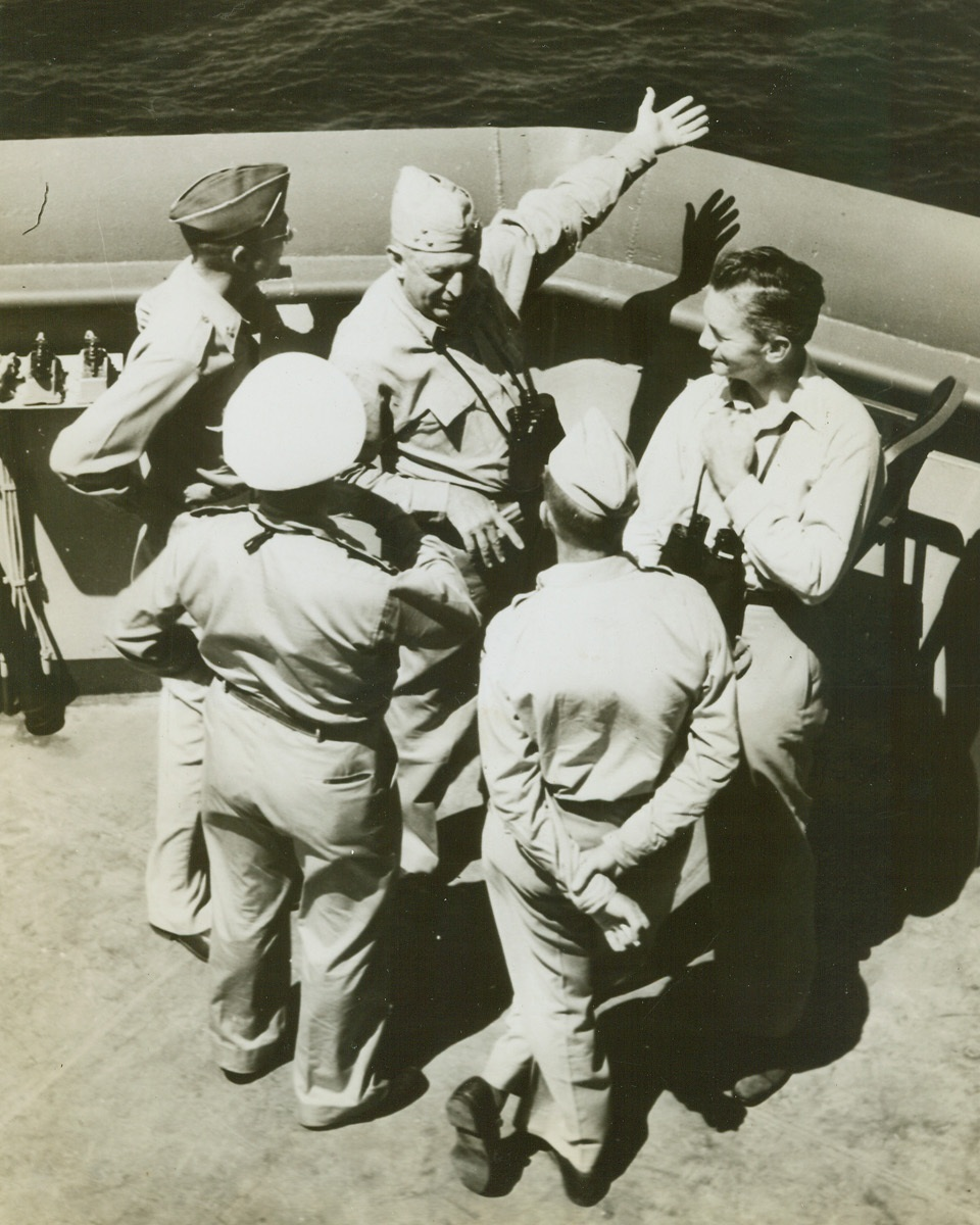 FORRESTAL SEES INVASION OF S FRANCE, 8/24/1944. Getting a first hand account of the workings of an invasion, Sec. of the Navy James Forrestal accompanied the Allied force which landed in Southern France. In this photo the secretary listens as Vice-Adm. H. Kent Hewitt, who was in command of the landing operations, gestures towards the objective while discussing tactics with (left to right) Maj. Gen. A.M. Patch, Jr. Commanding General, 7th Army; Contre Admiral (Rear Adm.) Andre Lemonnier, Commander, French Navel Forces, Mediterranean; and Brig. Gen. G.P. Saville, Commanding General, 12th Tactical Air Command; and Mr. Forrestal. Credit (U.S. Navy Photo from ACME);