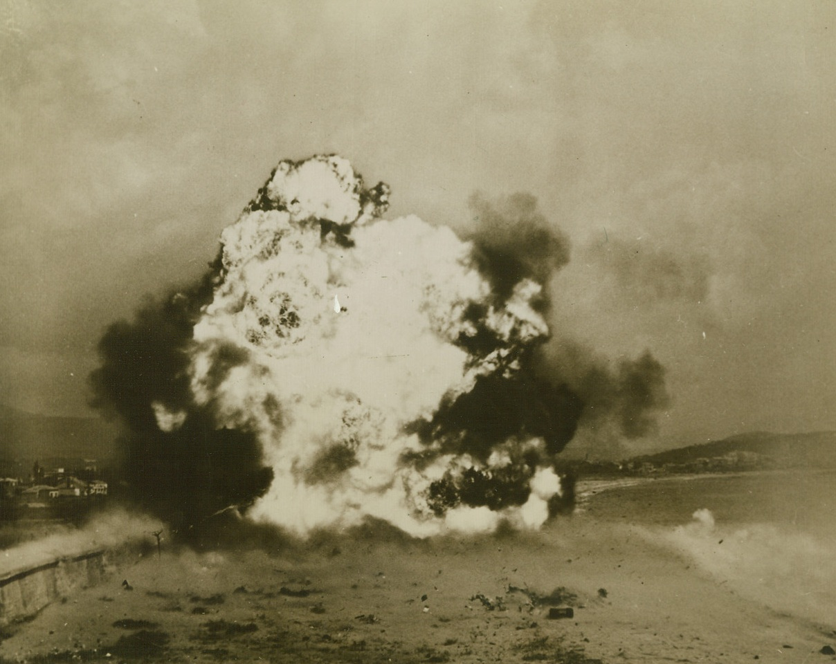 Open Way For Allied Advance, 8/31/1944. France - Blocked by an anti-tank wall, the Allied advance in Southern France was halted - but just fleetingly. Engineers of a demolition squad set to work with teller mines and blasted open a clear path for relentlessly advancing forces. The flash of explosion is seen as the mines go off. St. Raphael is in the background. Credit: Signal Corps photo from ACME;