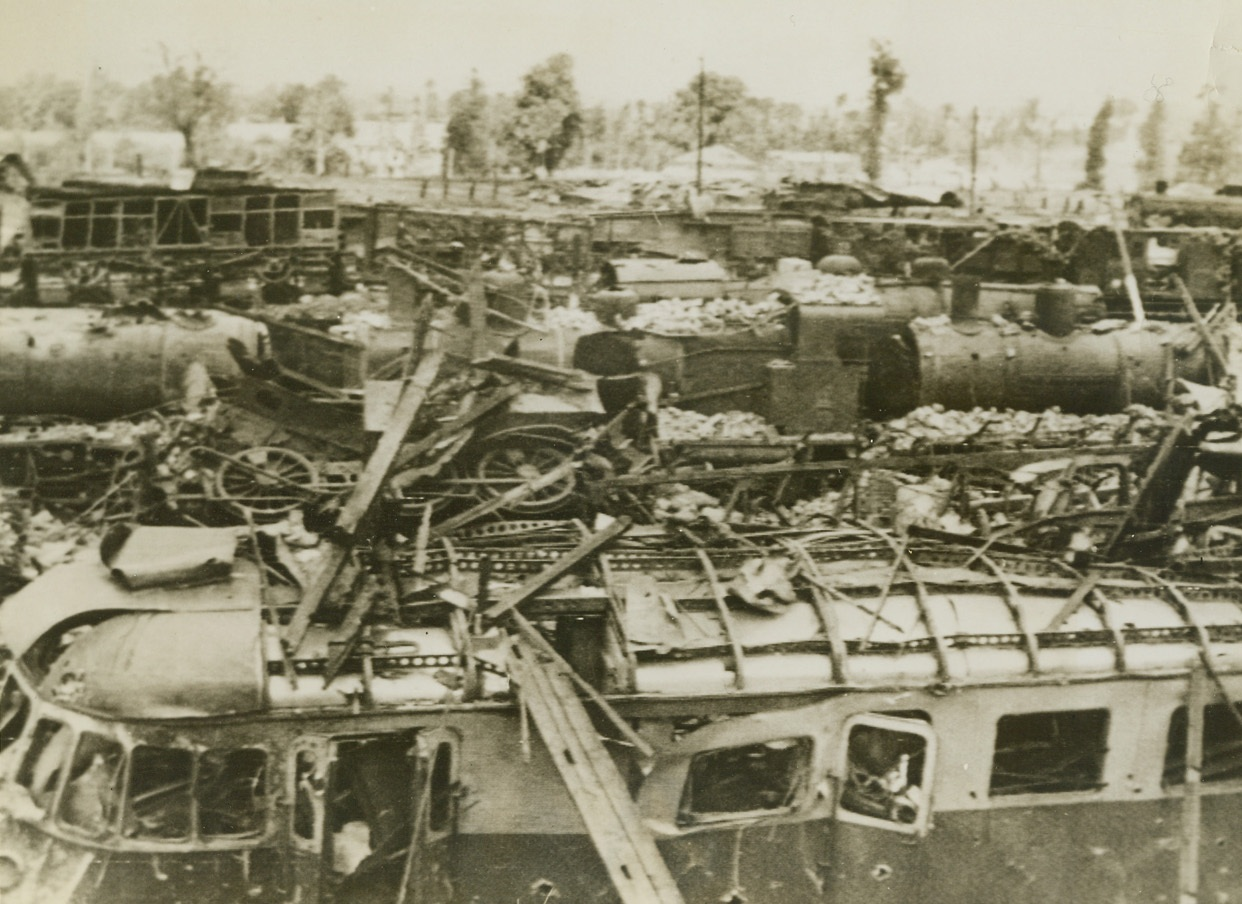 Another Nazi Communication Line Destroyed, 8/14/1944. Vire, France – Rolling stock and tracks in the Vire Railyard lie in shattered ruins after Allied Bombings which preceded the occupation of the city on August 7. Credit: British Official Photo via Signal Corps Radiotelephoto from ACME;