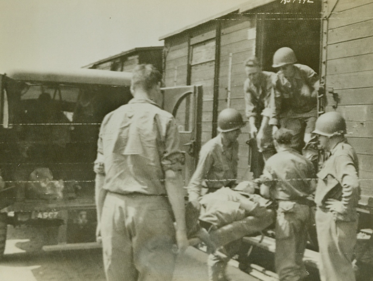 Load First Hospital Train, 8/8/1944. France – Wounded men are loaded aboard the first Allied hospital train to operate in France since D-Day, on a siding at Lison. They will be taken to Cherbourg on their way to England. Credit: Army photo from ACME;