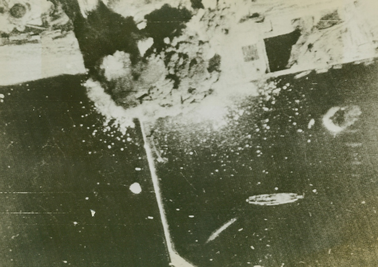 British Bomb Brest, 8/7/1944. Brest, France – Here's a bomber's-eye-view of the U-boat pens at Brest as RAF airmen strike heavily at their target. A direct hit is scored by a six-ton bomb on some of the concrete pens. Credit: British official photo via US Signal Corps from ACME;