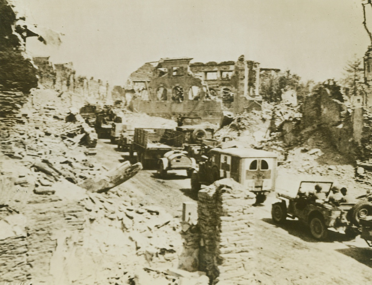 St. Lo Now at Yank Rear, 8/5/1944. France – Military traffic streams through devastated St. Lo, just a little while back the scene of terrific battles, but now far behind the fighting front. Yank advance through Brittany is at a speed almost greater than that achieved by any army in World War II. Credit: Army photo from ACME;