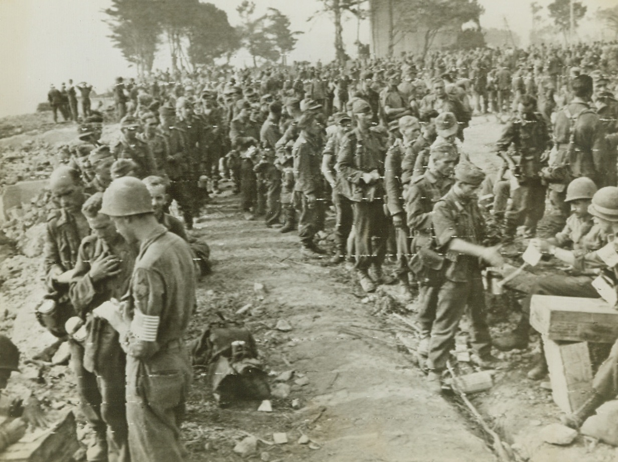France – Military traffic streams through devastated St. Lo, just a little while back the scene of terrific battles, but now far behind the fighting front. Yank advance through Brittany is at a speed almost greater than that achieved by any army in World War II. Credit: Army photo from ACME; , 8/22/1944. St. Tropez, France – Yanks in the rear lines are kept busy tabulating the war prisoners that come in by the thousands. Here American Military Police keep track of the droves of Nazi prisoners near St. Tropez, France, following their capture by Allies pushing northward from the southern France beachhead. Credit: US Army Radiotelephoto from ACME;