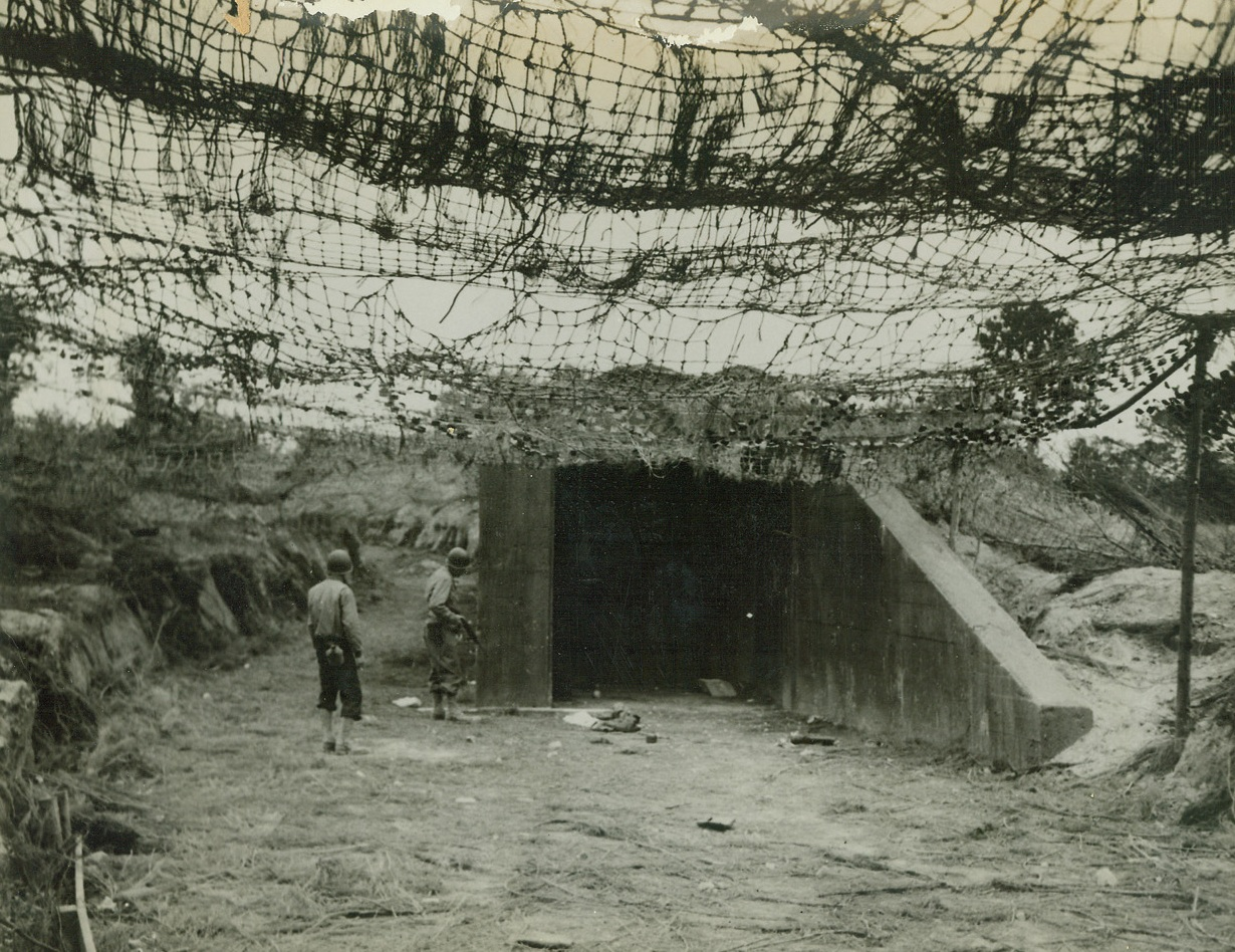 Jumping-Off Place For Robot Bombs, 8/8/1944. France – Allied soldiers examine the mouth of the ski building from which German robot bombs were to be launched for attacks on England. However, the building was left uncompleted when German workers fled in the face of the great Allied offensive drive. Credit: ACME;