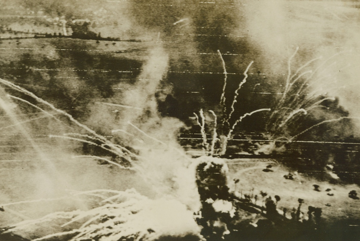 Nazi Ammo Dump Hits the Sky, 8/18/1944. France – A German ammunition dump, north of Falaise, France, blows sky high after a direct hit during a daylight attack by RAF bombers. Credit: British Ministry of Information photo via Army Radiotelephoto from ACME;