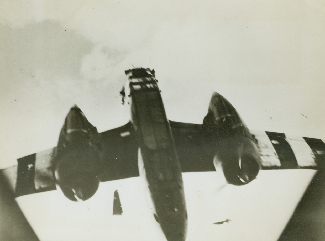 Shot to Pieces, 8/18/1944. The wreckage of the tail section of this A-20 Havoc light bomber of the 9th U.S. Air Force hurtles through the air after the plane was hit by enemy flak somewhere over France. The bomber's rudder is in an inverted position between the fuselage and the engine at right. The plane plunged to earth just after this photo was made. Credit: USAAF photo from Acme;