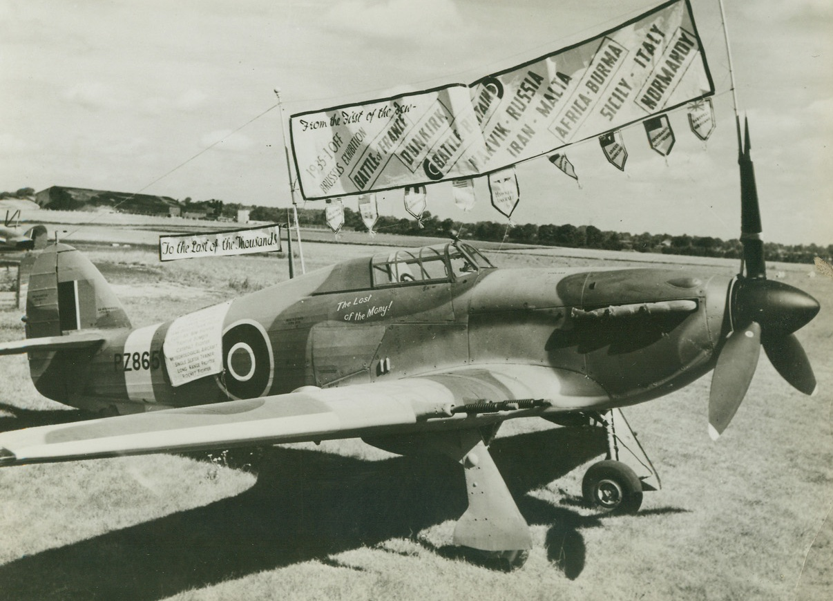 The Last of the Hurricanes, 8/22/1944. England – Fancifully decorated is this, the last Hurricane to be produced by the Hawker Aircraft Company. Banners and pennants describe the many achievements of the famous fighter. Credit: British Official Photo from ACME;