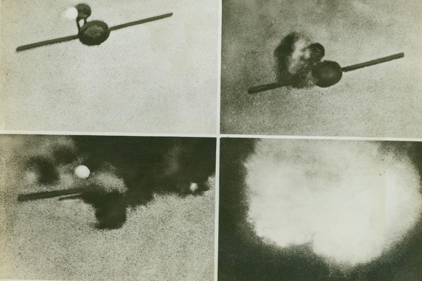 Hitler's V-1 Goes Kaput, 8/22/1944. England – These photos taken with an automatic camera fitted to a fighter plane flying over England show the death of one of Hitler's flying bombs—the V-1. At upper left the bomb, in full flight, tears toward its target at four miles a minute. Hit in a vital spot, as shown in upper right, the flying bomb falters and slows down. Smoke pours from its jet mechanism and fuselage. At lower left the weapon is in its death throes. Black clouds of smoke stream and almost completely envelope it. The fire spreads to the explosive war-head and in the last photo of this series, lower right, the bomb explodes harmlessly in a huge glare of light in mid-air. Credit: British Official Photo from ACME;