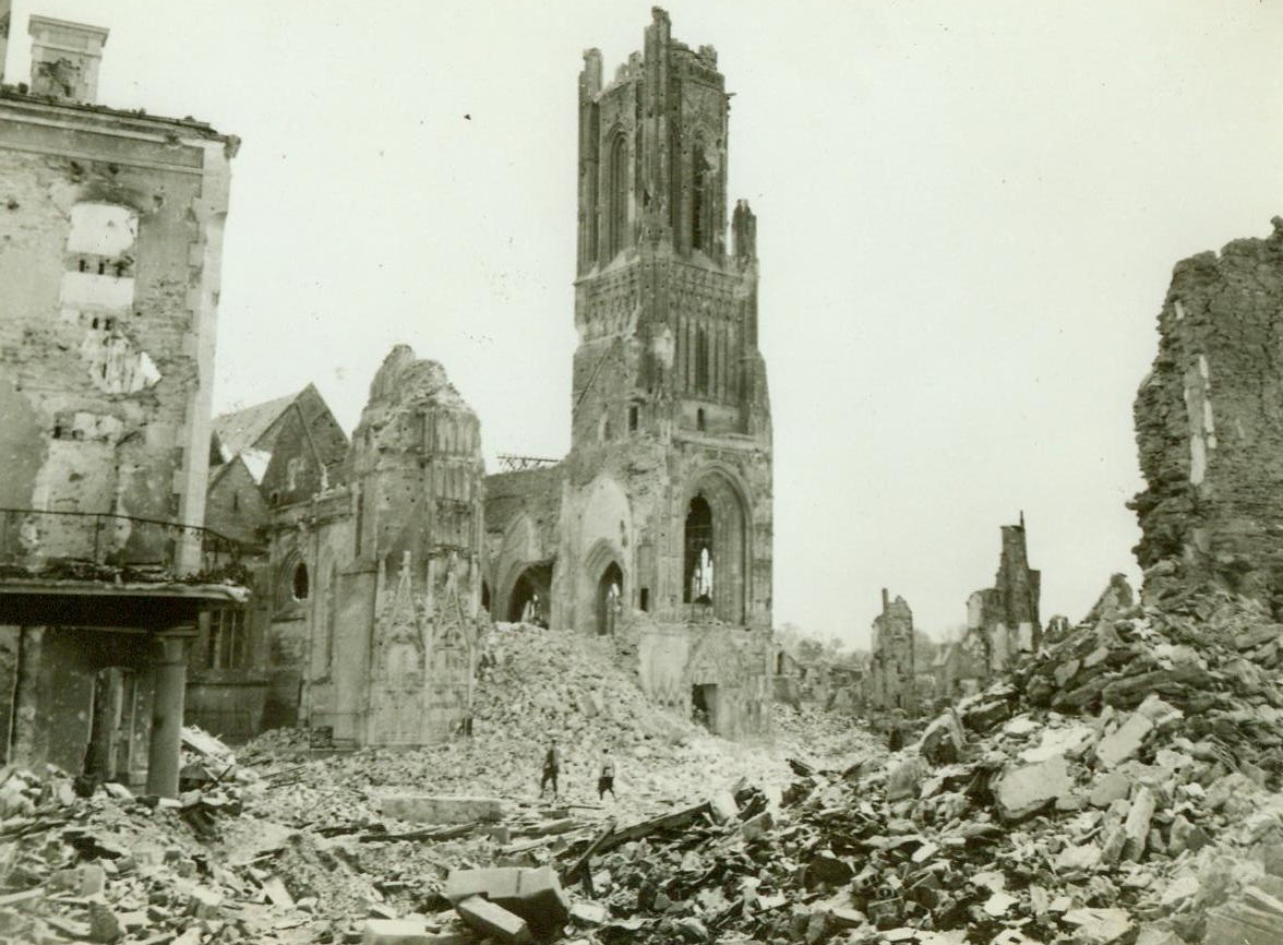 The Path Of War's Destruction, 8/2/1944. St. Lo, France – A French soldier and a GI stand among the ruins of St. Lo and gaze mutely at the Notre Dame Cathedral, which has been shattered throughout by the force of the battle in this key town. 8/2/44 (ACME);
