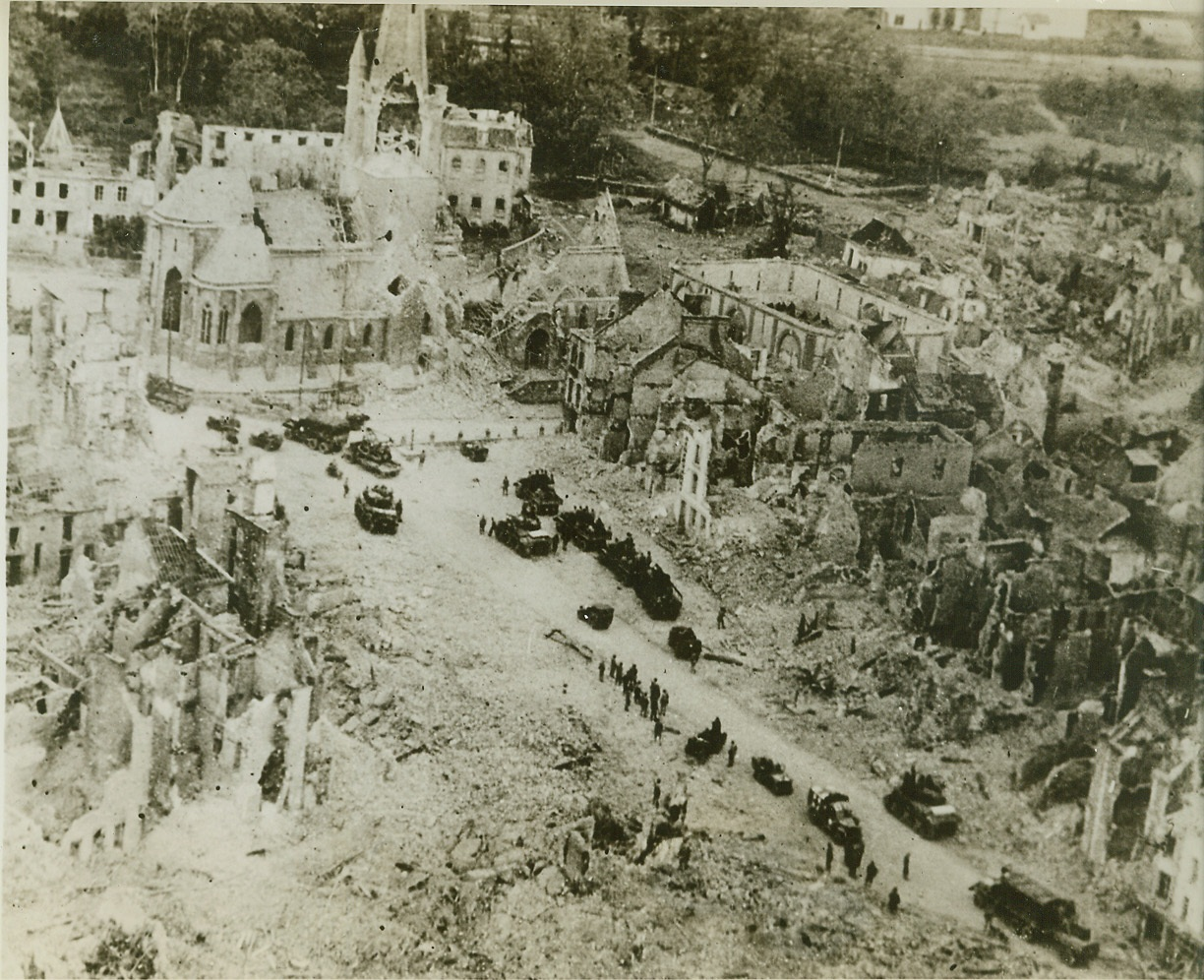 The Aftermath of Battle, 8/6/1944. PERIERS, FRANCE -- American tanks and trucks wend their way into Periers, a mass of destruction from the fierce battle that preceded its capture. American forces have stormed into Brest, France's 2nd port, completing the isolation of the Brittany Peninsula from German forces in the remainder of France. Credit (ACME) (WP);