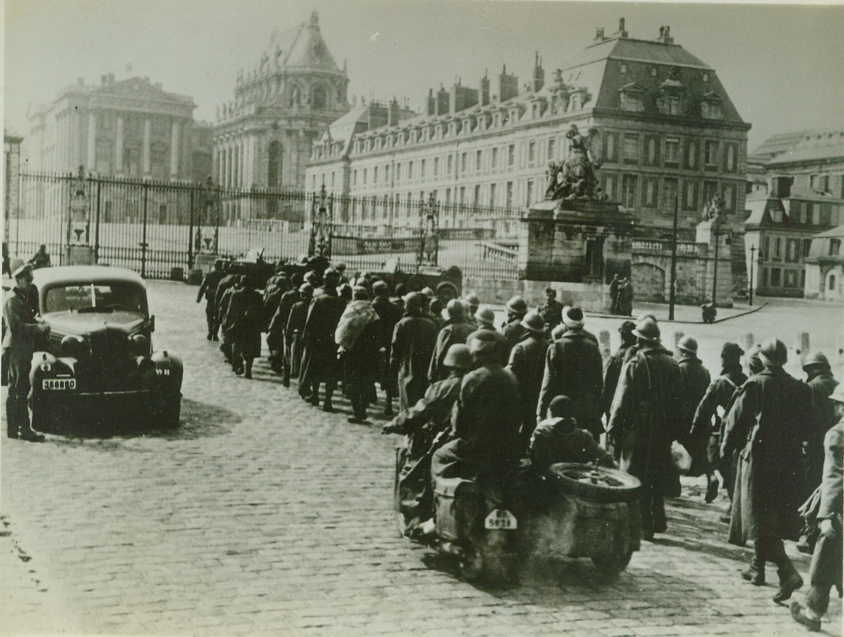 Allies Strike to Free Paris, 8/7/1944. PARIS, FRANCE -- Nazis in Paris march French prisoners past the Palace of Versailles where the Treaty, which the Germans say was the cause of the war, was signed. After four years of Nazi rule, Paris is once more a military objective as American armored columns race at terrific speed to free the French capital. EDITORS: We have prepared this art for possible use when Allied forced enter Paris. Credit: (ACME);