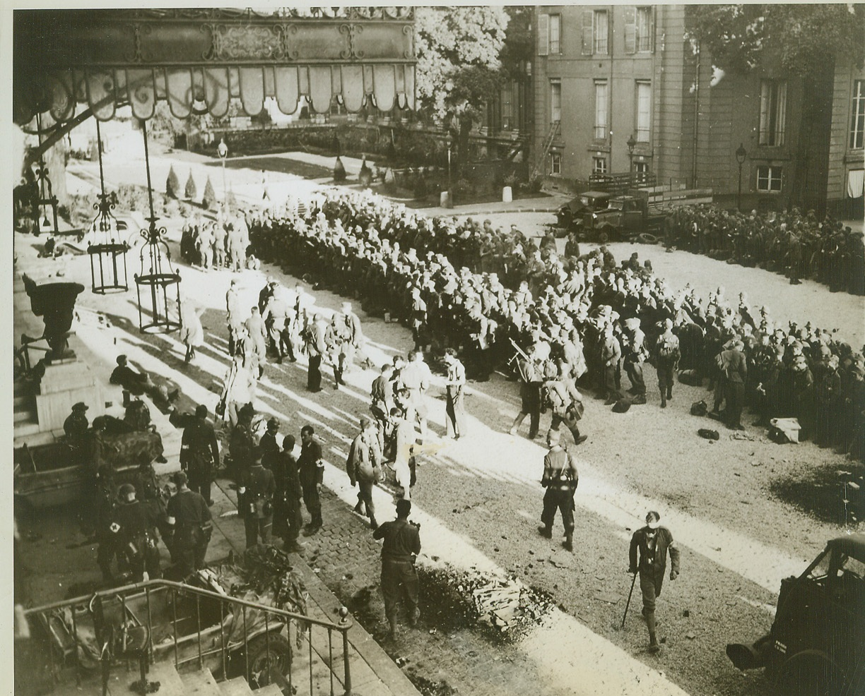 France Regains Its Chamber of Deputies, 8/30/1944. France—Some of the 400 Germans who barricaded themselves in the Chamber of Deputies in Paris and fought off liberating troops are lined up in the courtyard after surrending to French partisan forces.  Credit: ACME;