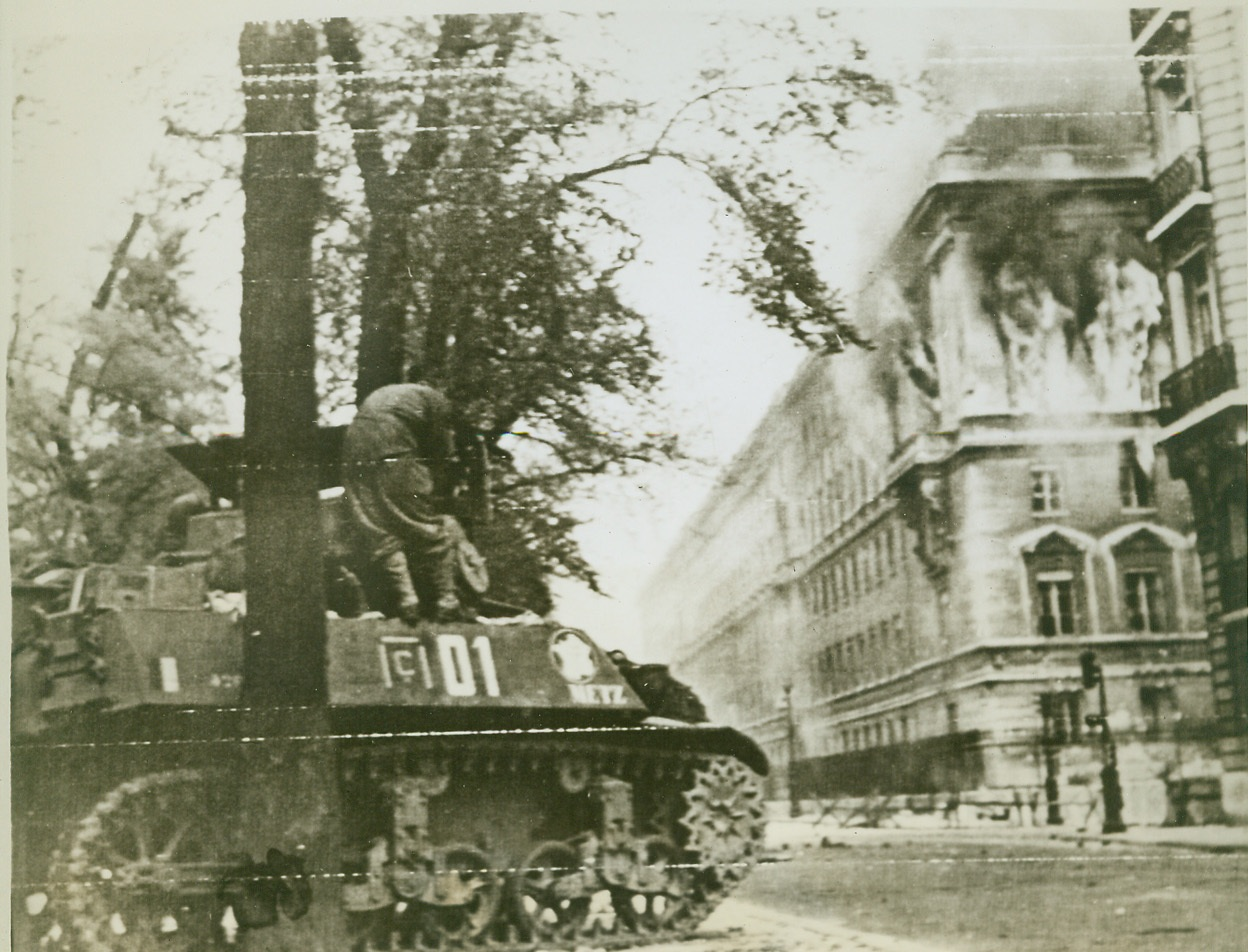 Chamber of Deputies Burns, 8/28/1944. Paris—Flames and smoke pour from the windows of the Chamber of Deputies in Paris, which was used as a defense point by German troops and French fascists. A free French tank halts in the street below. Credit: ACME photo via Army radiotelephoto;