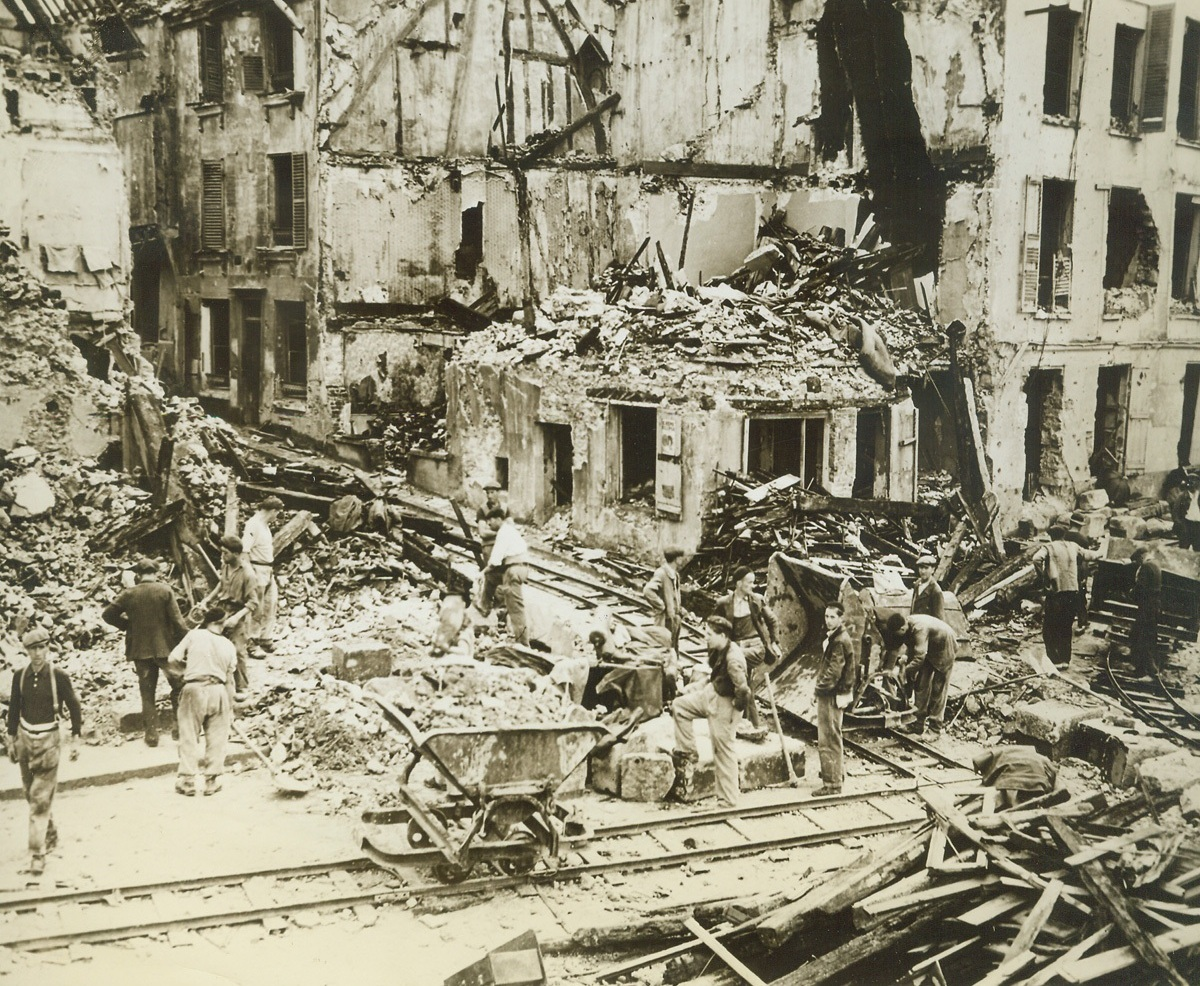 Digging Out After Liberation By American Army, 8/29/1944. MANTES, FRANCE - Damage done by Nazi demolition teams as they left town to Yanks.;