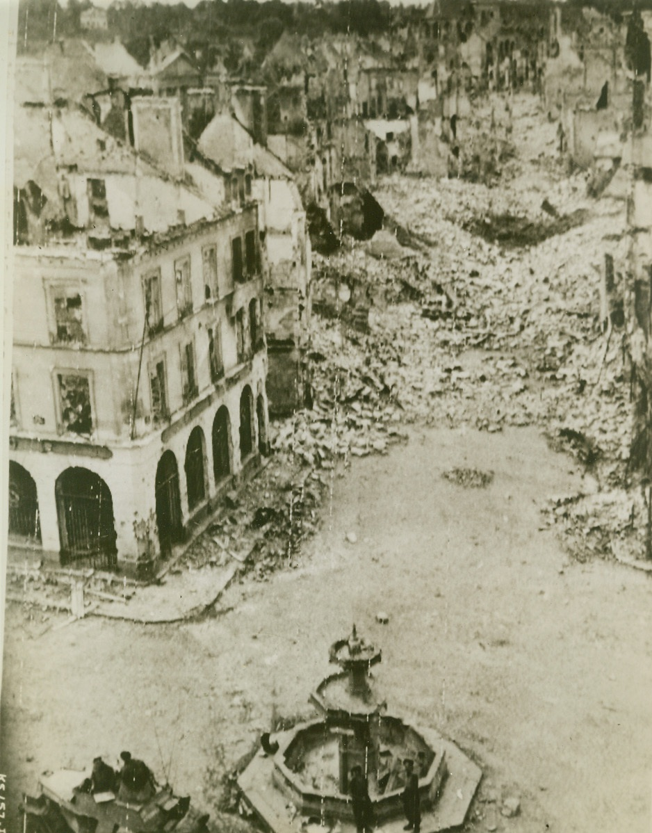 Falaise—City of Destruction, 8/18/1944. France—Heaps of broken masonry line the shell-torn streets of Falaise, France, taken by Canadian troops after hard and bitter fighting. Houses are gutted and the city is but a ghost town after Nazi demolition squads finished their destructive tasks.  Credit: Army radiotelephoto from ACME;