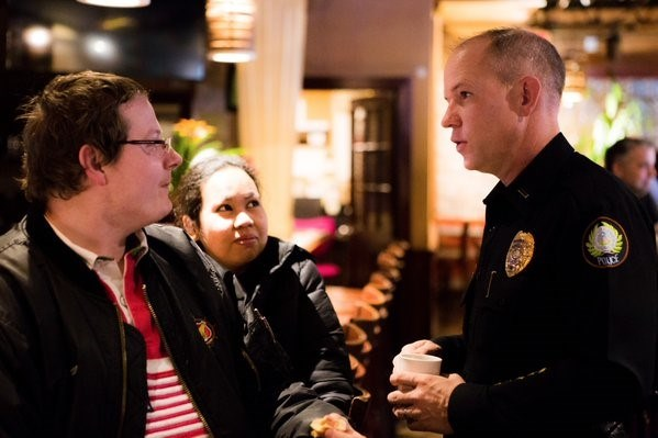 Lieutenant Steven McClanahan talks with citizens on neighborhood concerns