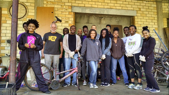 Group shot photo of volunteers with Ron King at Recycle Bikes for Kids.